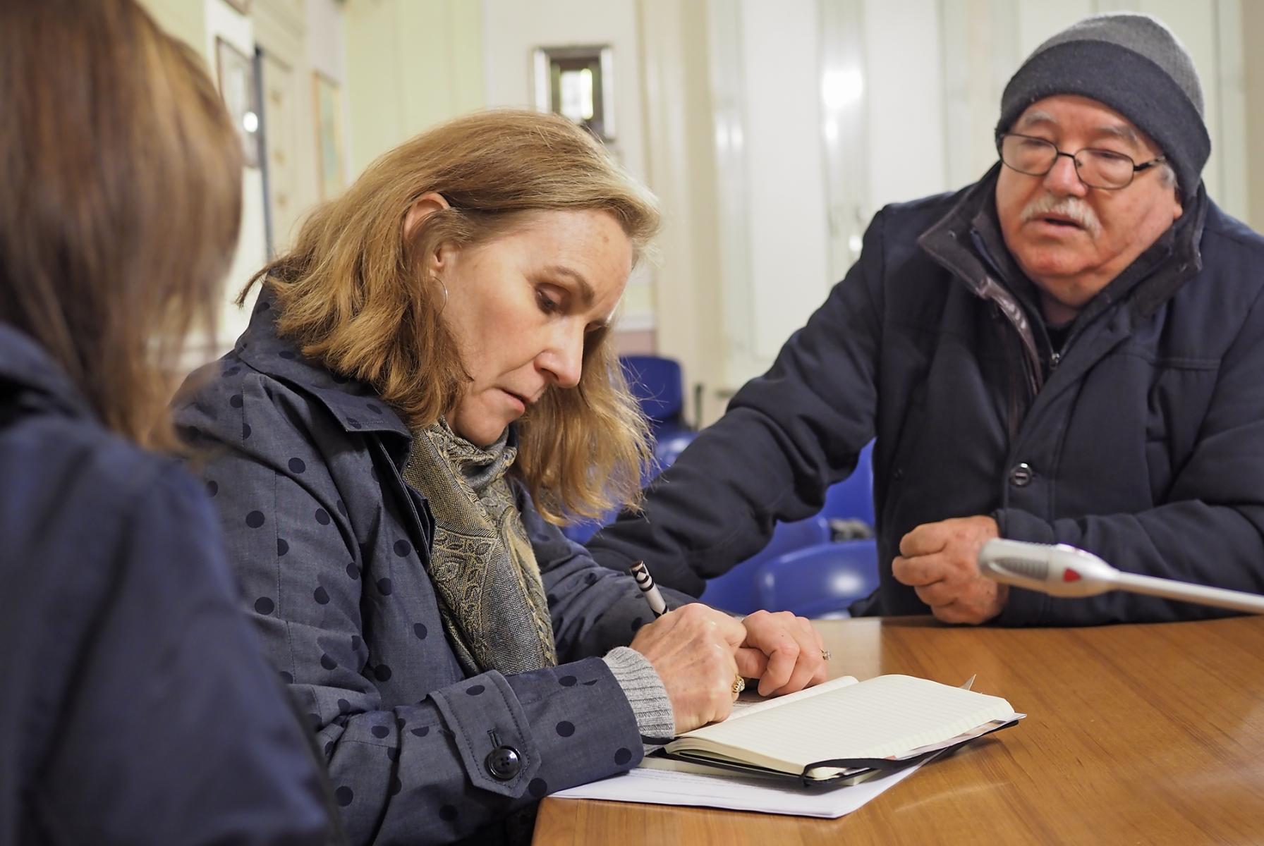 Caitlin interviews a local historian in Calabria.